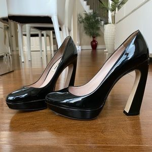 Miu Miu Curved Heel Patent Leather Pumps